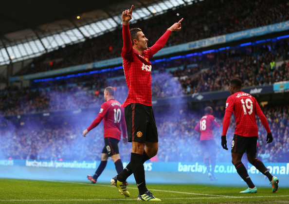 Robin van Persie celebrates after scoring the winner against City.